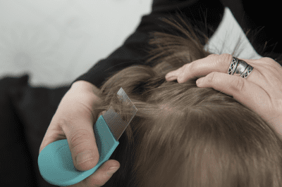 Child getting checked for head lice. Lice Lifters Treatment Centers, Dallas, Texas